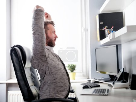 Man in desk office suffering from back pain