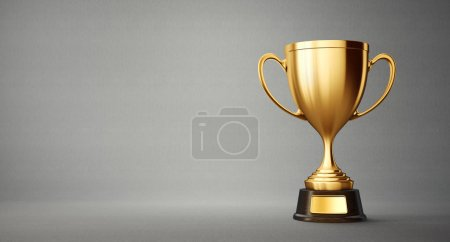 golden winner cup on grey background