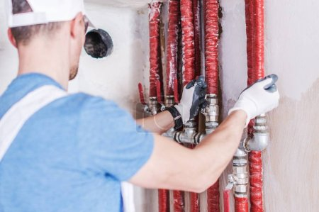 Photo for Plumbing Water Supply Check. Caucasian Plumber Worker Testing Installation. - Royalty Free Image