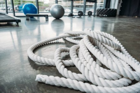 closeup shot of training rope on floor at gym