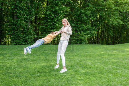 happy mother with cute little son having fun together in park