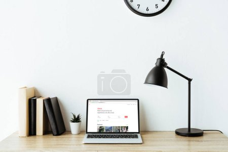 Photo for Laptop with airbnb website on screen on work desk at office - Royalty Free Image