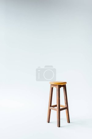 Photo for Single vintage wooden stool on white - Royalty Free Image