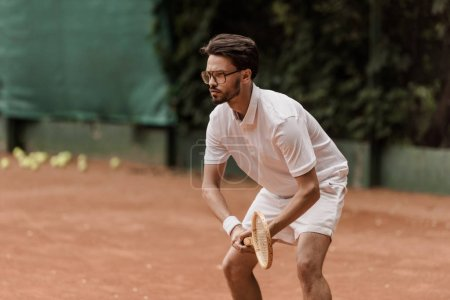 Photo for Focused retro styled tennis player during game at tennis court - Royalty Free Image