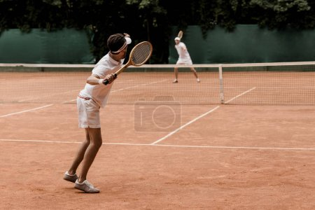 retro styled tennis players playing at tennis court