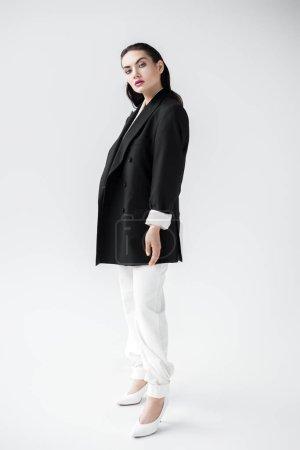 beautiful fashionable girl posing in black jacket, isolated on grey