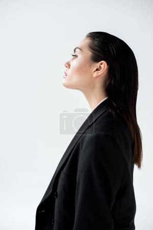 profile portrait of attractive glamour girl in black jacket, isolated on grey