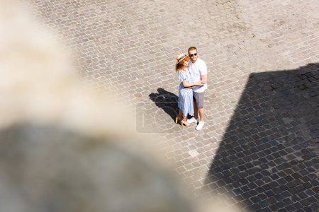 Photo for Selective focus of redhead couple embracing each other at urban street - Royalty Free Image