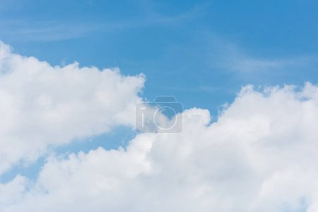 Photo for Full frame image of bright blue sky with clouds background - Royalty Free Image