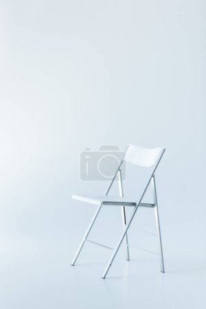one white chair, isolated on white with copy space