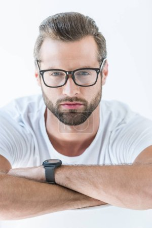 portrait of bearded brunet man in eyeglasses, isolated on white