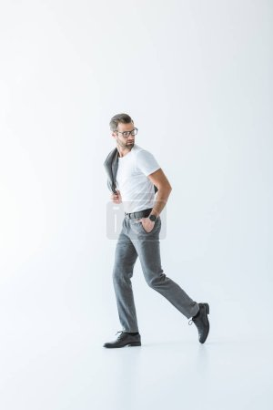 elegant stylish man in white t-shirt and gray suit, isolated on white