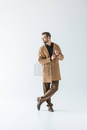 stylish man in brown autumn coat, isolated on white