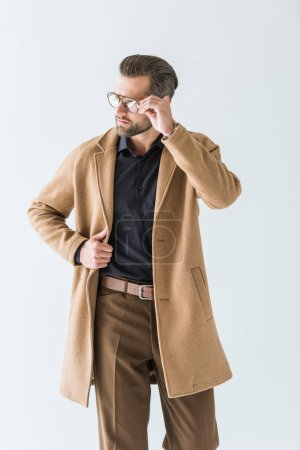 stylish man posing in eyeglasses and autumn outfit, isolated on white