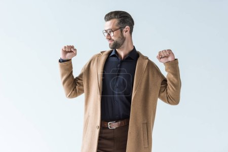 Photo for Excited man gesturing and posing in autumn brown coat, isolated on white - Royalty Free Image