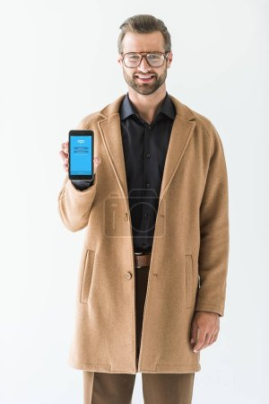 handsome man presenting smartphone with skype appliance, isolated on white
