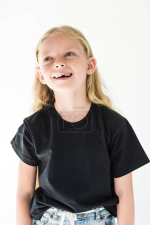 portrait of adorable happy child in black t-shirt laughing and looking away isolated on white