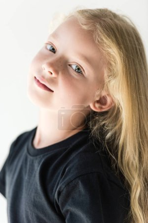 portrait of beautiful kid with long curly hair looking at camera isolated on white