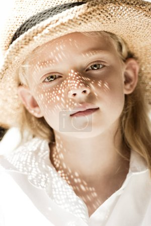 Photo for Close-up portrait of adorable child in wicker hat looking at camera - Royalty Free Image