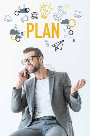 Photo for Handsome businessman talking on smartphone, isolated on white with plan icons - Royalty Free Image