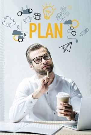 thoughtful businessman sitting at workplace with plan icons
