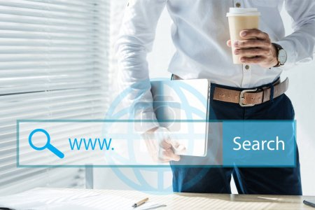 cropped view of seo developer holding laptop and coffee to go, with website search bar