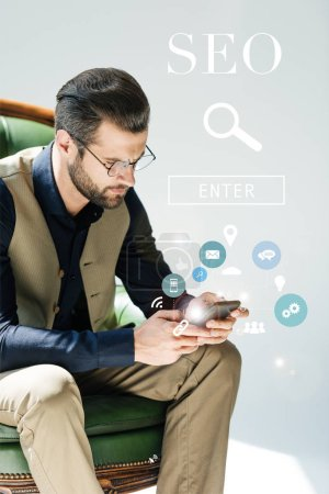 stylish bearded developer using smartphone, with SEO search and icons