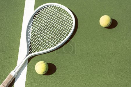 close up view of tennis equipment on green tennis court