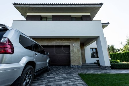 facade of new modern house with car on parking