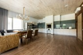 interior view of stylish empty kitchen and dining room