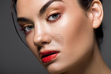 Photo for Attractive fashionable model with makeup on face, isolated on grey - Royalty Free Image