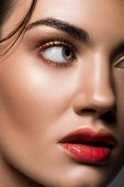 close up of attractive model posing with makeup on face
