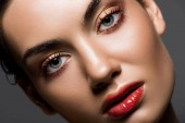 close up of attractive stylish model with makeup of face, isolated on grey