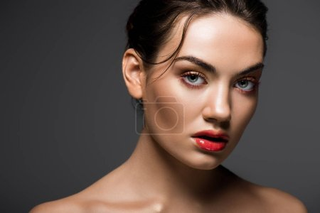 attractive stylish girl with makeup posing for fashion shoot, isolated on grey