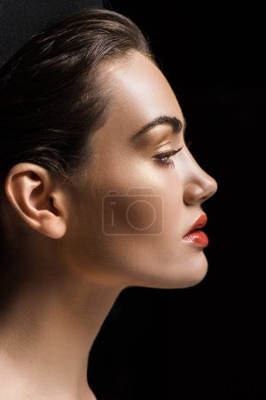 profile portrait of attractive stylish girl with makeup, isolated on black
