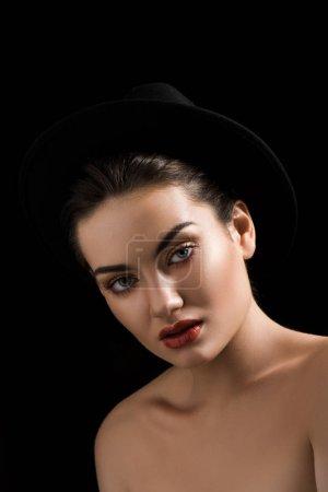 beautiful fashionable girl posing in trendy felt hat, isolated on black