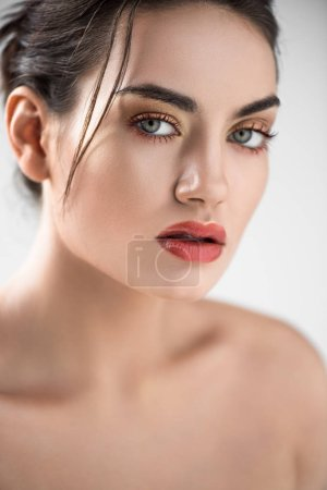 attractive stylish girl with makeup, isolated on grey