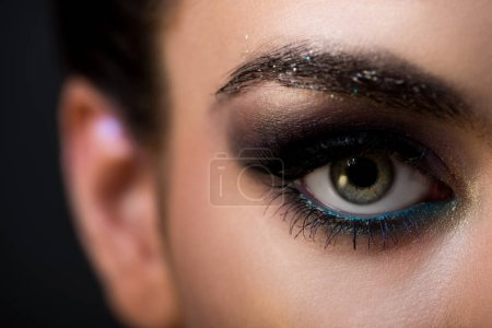 close up of attractive girl with fashionable makeup on eye, isolated on grey