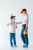 mother palming son and they looking at each other during playing baseball isolated on white