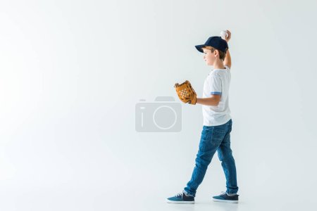 adorable boy pitching baseball ball isolated on white