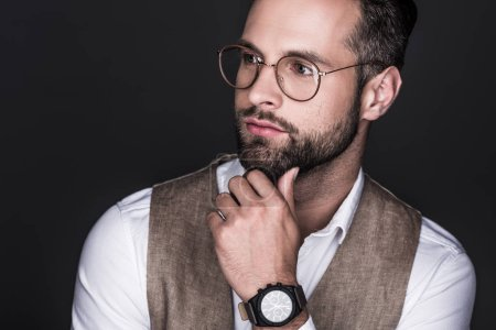 Photo for Portrait of handsome pensive man posing in eyeglasses, isolated on grey - Royalty Free Image
