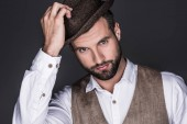 portrait of handsome bearded man in stylish hat, isolated on grey