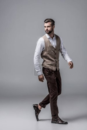 Photo for Bearded stylish man posing in elegant vest on grey - Royalty Free Image