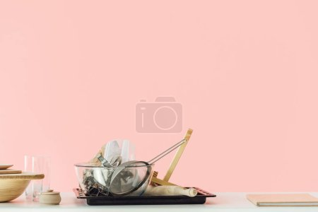 Photo for Various messy cooking utensils on table isolated on pink - Royalty Free Image