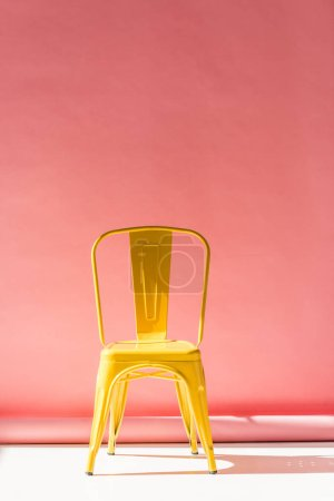 Photo for Studio shot of trendy yellow chair and on pink - Royalty Free Image