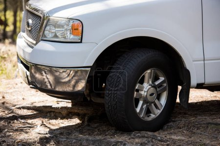 close up of white pickup truck outdoors