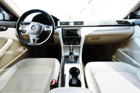 Photo for Close up of steering wheel and beige leather seats new car on street - Royalty Free Image