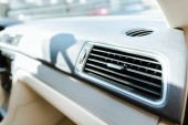 close up of car air conditioner grid panel