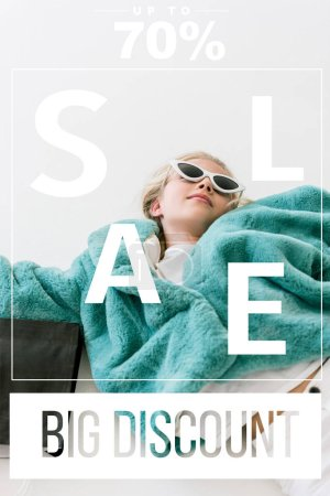 beautiful stylish child in turquoise fur coat lying with black shopping bag on white, big discount sale banner concept