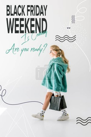 blonde female child in turquoise fur coat posing with black shopping bags on white, black friday weekend sale banner concept